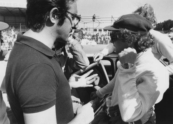 Dijon-Prenois, France. 1st - 3rd July 1977. Niki Lauda (Ferrari 312T2) 5th position, in conversation with Mauro Forghieri, Technical Director of Ferrari, portrait. World Copyright: LAT Photographic. Ref: Motor B/W Print.