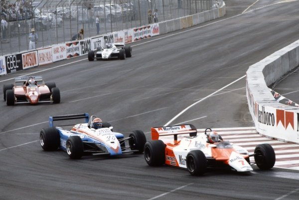 1982 Las Vegas Grand Prix. Caesars Palace, United States. 25 September 1982. John Watson (McLaren MP4/1B Ford) leads Eddie Cheever (Talbot Ligier JS19 Matra), Mario Andretti (Ferrari 126C2) and Derek Daly (Williams FW08 Ford). Watson, Cheever and Daly finished in 2nd, 3rd and 6th positions respectively which was not enough for Watson to clinch the title, action.  World Copyright: LAT Photographic Ref: 35mm transparency 82LV21
