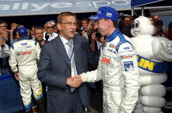 Rally winner Markko Martin (EST) is congratulated by the Estonian Prime Minister Juhan Parts.FIA World Rally Championship, Rd9, Neste Rally Finland, Jyvaskyla, Finland, Day 3, 10 August 2003.DIGITAL IMAGE