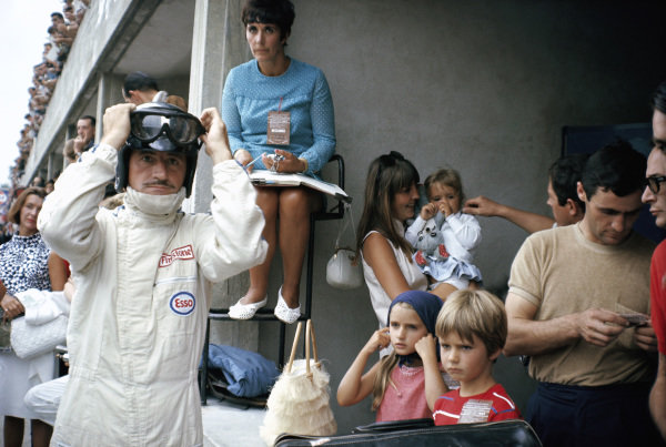 Graham Hill, surrounded by his family: wife Bette, and a nanny who looks after the three children.