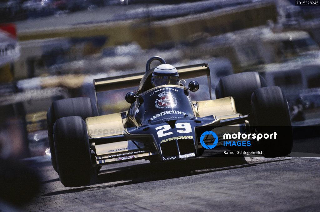Riccardo Patrese, Arrows A1B Ford, bounces over a kerb.