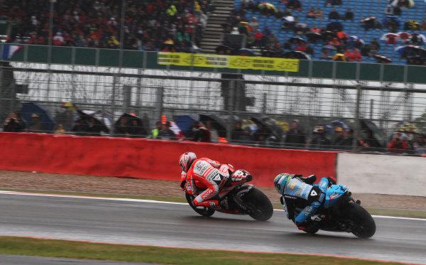 British Grand Prix.  Silverstone, England. 10th-12th June 2011.  Nicky Hayden, Ducati, leads Alvaro Bautista, Suzuki. Action.  World Copyright: Kevin Wood/LAT Photographic.  ref: Digital Image