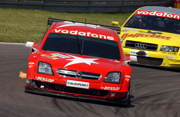 2004 DTM ChampionshipAdria, Italy. 15th - 16th May 2004.Heinz Harald Frentzen (OPC Holzer Opel Vectra GTS) leads Tom Kristensen (Abt Sportsline Audi A4), action.World Copyright: Andre Irlmeier/LAT Photographicref: Digital Image Only