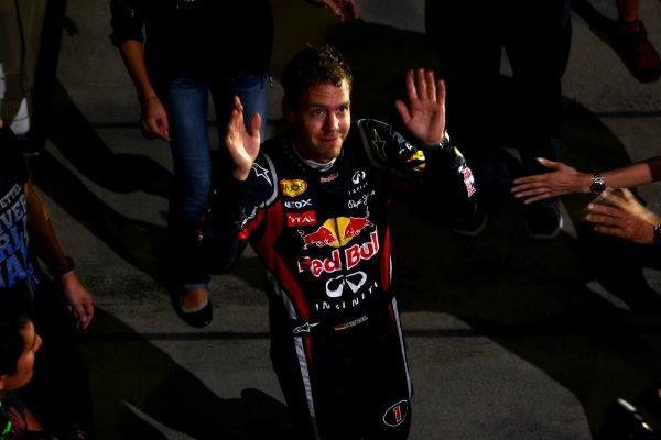 Suzuka Circuit, Suzuka, Japan.9th October 2011.Sebastian Vettel, Red Bull Racing RB7 Renault, 3rd position, celebrates his second world championship with his team. Portrait. Atmosphere. World Copyright: Andy Hone/LAT Photographicref: Digital Image CSP26117