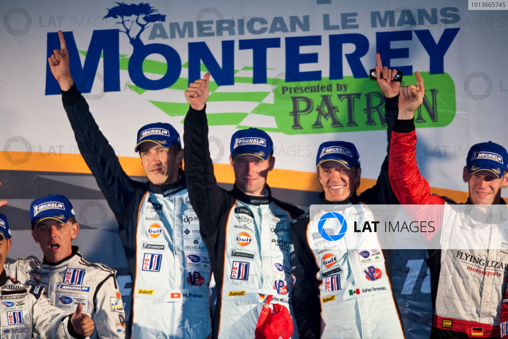 American Le Mans Series. Laguna Seca, Monterey, California. 15th - 17th September 2011. Adrian Fernandez / Harold Primat / Stefan Mucke, Aston Martin Racing, AMR / Lola Coupe B09 60 celebrate victory on the podium. Portrait. Photo: Drew Gibson/LAT Photographic. ref: Digital Image _Y2Z7194