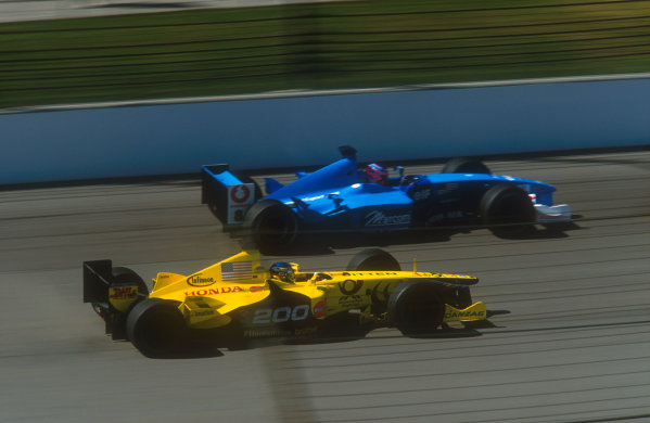 2001 United States Grand Prix.Indianapolis, Indiana, USA.28-30 September 2001.Jean Alesi (Jordan EJ11 Honda) races with Jenson Button (Benetton B201 Renault). He finished in 6th position in his 200th Grand Prix outing. Button was 8th position.Ref-01 USA 09.World Copyright - LAT Photographic