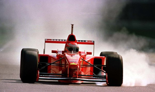 1997 German Grand Prix.Hockenheim, Germany.25-27 July 1997Eddie Irvine (Ferrari F310B) locks up during qualifying.World Copyright - LAT Photographic