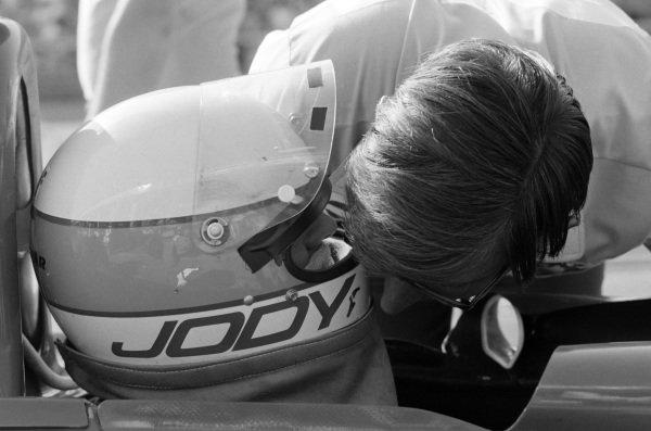 Jody Scheckter talks to Ken Tyrrell in pitlane.