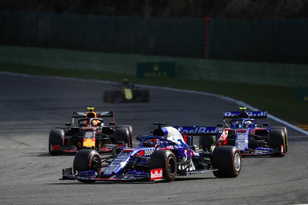 Daniil Kvyat, Toro Rosso STR14, leads Pierre Gasly, Toro Rosso STR14, and Alexander Albon, Red Bull RB15