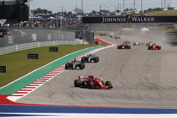 Kimi Raikkonen, Ferrari SF71H, leads Lewis Hamilton, Mercedes AMG F1 W09 EQ Power+, Valtteri Bottas, Mercedes AMG F1 W09 EQ Power+, Daniel Ricciardo, Red Bull Racing RB14, and Sebastian Vettel, Ferrari SF71H, at the start of the race
