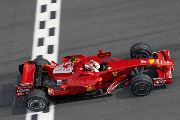 Kimi Räikkönen, Ferrari F2008 celebrates victory as he crosses the finish line.