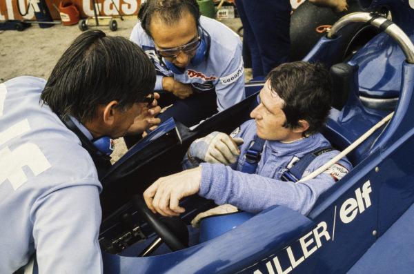 Patrick Depailler talks with Ken Tyrrell.