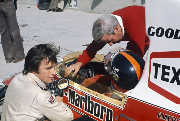Emerson Fittipaldi talks with team boss Teddy Mayer in the pits.