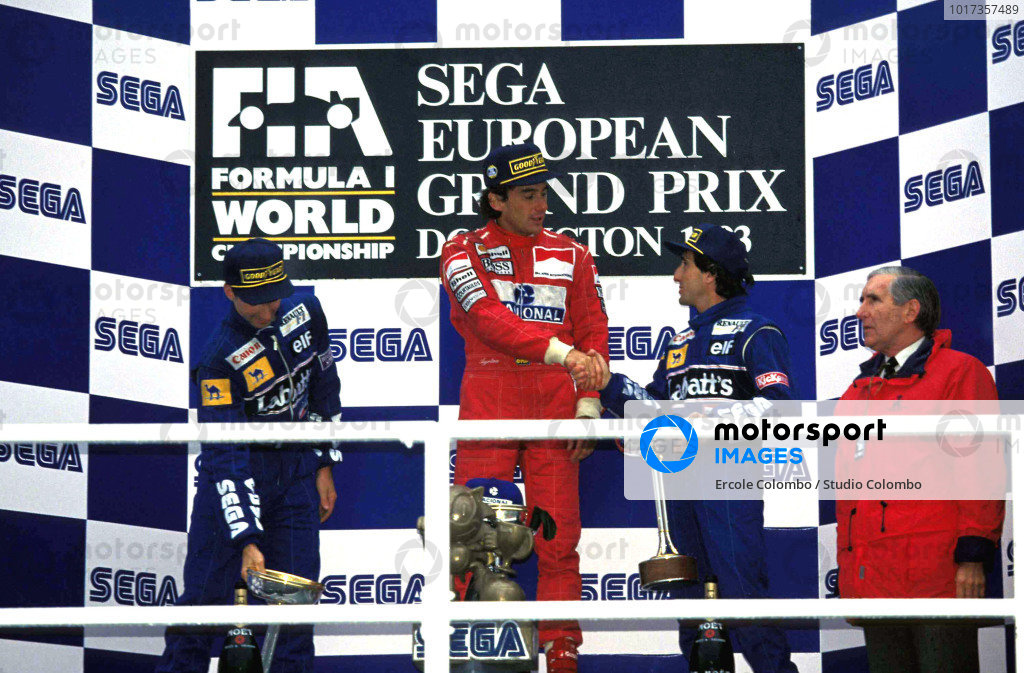 Damon Hill, 2nd position, Ayrton Senna, 1st position, and Alain Prost, 3rd position, on the podium.