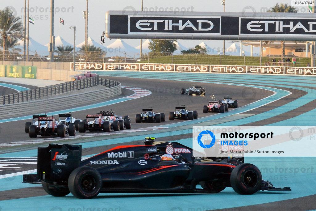 Fernando Alonso (ESP) McLaren MP4-30 and Pastor Maldonado (VEN) Lotus E23 Hybrid collide at the start of the race at Formula One World Championship, Rd19, Abu Dhabi Grand Prix, Race, Yas Marina Circuit, Abu Dhabi, UAE, Sunday 29 November 2015. BEST IMAGE