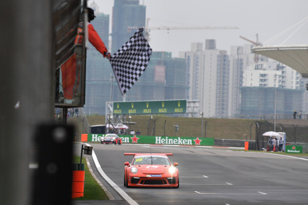 Philip Hamprecht (GER) Team StarChase takes the chequered flag at Porsche Carrera Cup Asia, Shanghai, China, 13-15 April 2018.