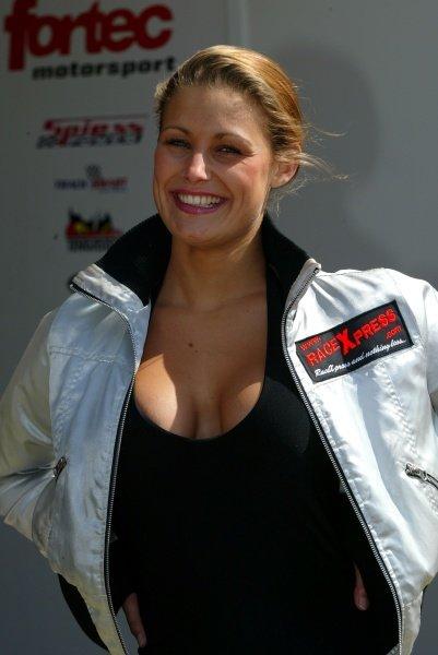 A smiling woman in the pitlane.Marlboro Masters of F3, Zandvoort, Holland, 10-12 June 2005.DIGITAL IMAGE