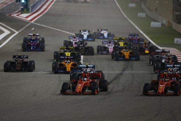 Sebastian Vettel, Ferrari SF90, leads Charles Leclerc, Ferrari SF90, Lewis Hamilton, Mercedes AMG F1 W10, Valtteri Bottas, Mercedes AMG W10, Max Verstappen, Red Bull Racing RB15, Kevin Magnussen, Haas VF-19, and the rest of the field at the start