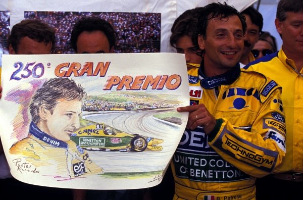 Riccardo Patrese (ITA) Benetton, celebrates his 250th Grand Prix by being presented with a sketch of himself. Formula One World Championship, Rd10, German Grand Prix, Hockenheim, Germany. 25 July 1993. BEST IMAGE