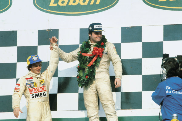 Montreal, Quebec, Canada. 28 - 30 September 1979.Alan Jones (Williams FW07-Ford), 1st position and Gilles Villeneuve (Ferrari 312T4) 2nd position on the podium, portrait. World Copyright: LAT Photographic.Ref:  79CAN05.