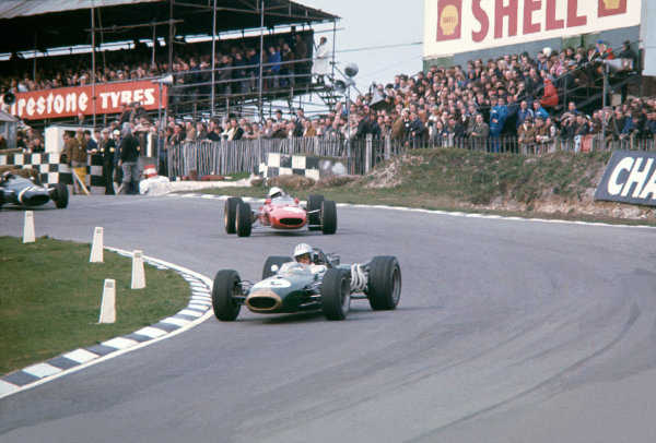 Brands Hatch, England. 12th March 1967.Denny Hulme (Brabham BT20-Repco), Did Not Start Final, leads Lorenzo Bandini (Ferrari 312), 2nd position, action. World Copyright: LAT Photographic.Ref:  67ROC03