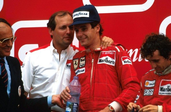Winner Alain Prost (FRA), 2nd place Gerhard Berger (AUT) with Ron Dennis (GBR) Mclaren Chief Executive, celebrate the finish on the podium Portuguese Grand Prix, Estoril, 20th August 1987