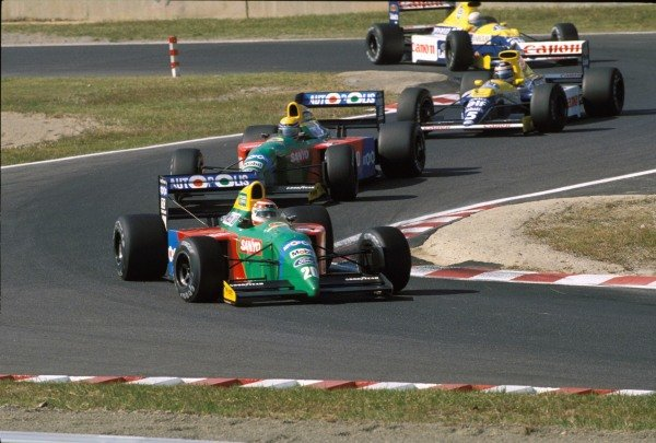 Nelson Piquet, Benetton B190 Ford, leads Roberto Moreno, Benetton B190 Ford, Thierry Boutsen, Williams FW13B Renault, and Riccardo Patrese, Williams FW13B Renault.