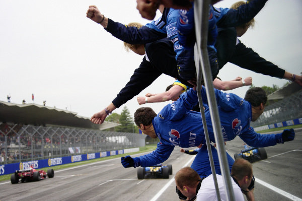 Renault mechanics cheer as Fernando Alonso claims another victory.