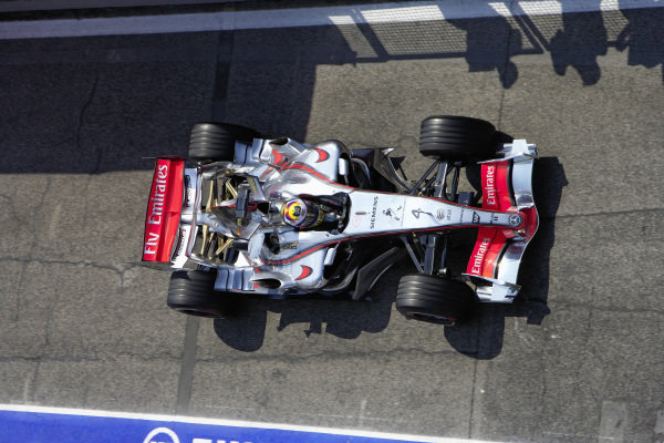 Juan Pablo Montoya, McLaren MP4-21 Mercedes drives down the pitlane.