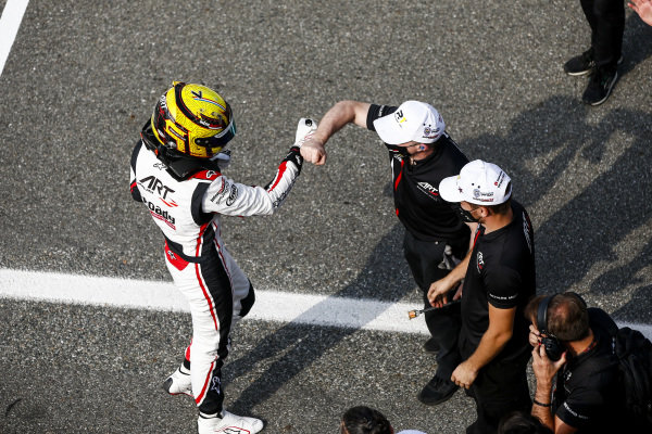 Theo Pourchaire (FRA, ART GRAND PRIX) celebrates in Parc Ferme with his team