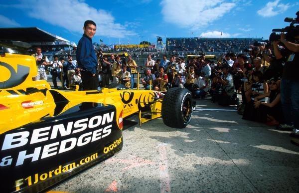 Takuma Sato (JPN) poses in front of the Jordan EJ11. He will drive for the team in 2002. Japanese Grand Prix, Suzuka, Japan, 14 October 2001 BEST IMAGE
