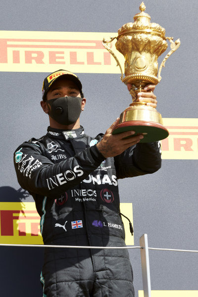 Winner Lewis Hamilton, Mercedes-AMG Petronas F1, celebrates on the podium and holds his trophy