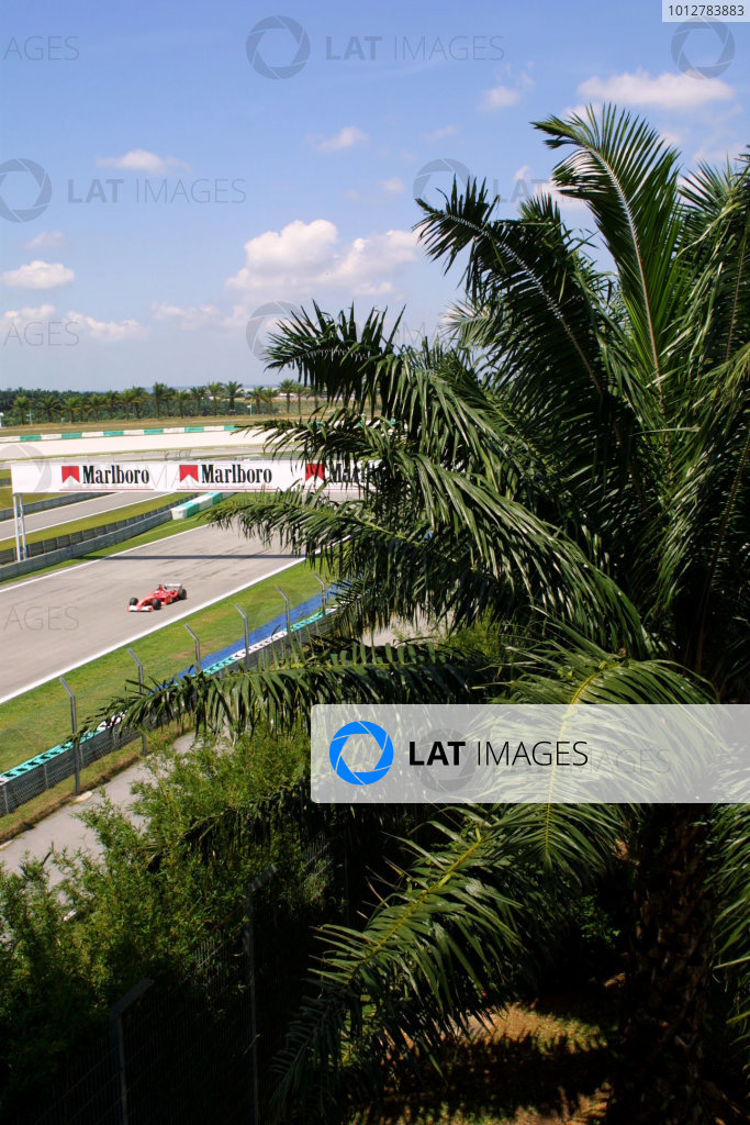 2003 Malaysian Grand Prix. Sepang, Kuala Lumpur, Malaysia.21-23 March 2003.Michael Schumacher (Ferrari 2002) 6th position.World Copyright - LAT Photographic ref: Digital Image Only