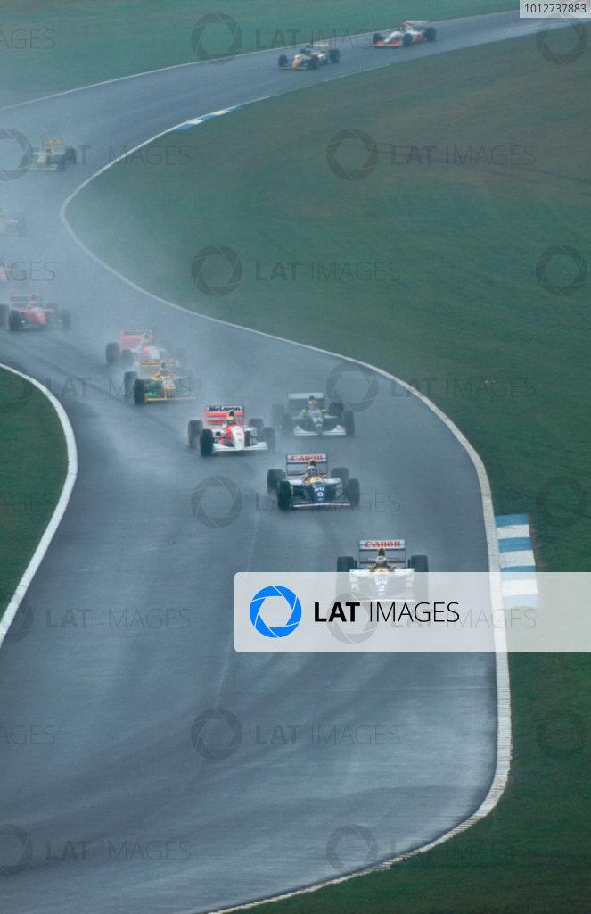 1993 European Grand Prix. Donington Park, England. 9-11 April 1993. Alain Prost leads teammate Damon Hill (both Williams FW15C Renault's), Ayrton Senna (McLaren MP4/8 Ford), Karl Wendlinger (Sauber C12 Ilmor), Michael Schumacher (Benetton B193B Ford), Michael Andretti (McLaren MP4/8 Ford) and Jean Alesi (Ferrari F93A) through Craner Curves to the Old Hairpin at the start.  Ref-93 EUR 08. World Copyright - LAT Photographic