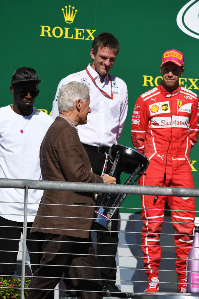 Bill Clinton (USA) with the winners trophy on the podium at Formula One World Championship, Rd17, United States Grand Prix, Race, Circuit of the Americas, Austin, Texas, USA, Sunday 22 October 2017.
