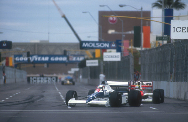 1990 United States Grand Prix.Phoenix, Arizona, USA.9-11 March 1990.Jean Alesi (Tyrrell 018 Ford) leads Ayrton Senna (Mclaren MP4/5B Honda). They finished in 2nd and 1st positions respectively. World Copyright - LAT Photographic