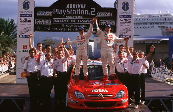 2001 FIA World Rally ChampsRallye de France, Ajaccio, Corsica, 18th-21st October 2001.First ever Citreon win, drivers Jesus Puras and M Martin celebrate on the Podium.World Copyright: LAT Photographic/McKlein.ref: 35mm Image A05