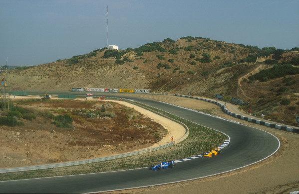 1990 Spanish Grand Prix.Jerez, Spain.28-30 September 1990.Philippe Alliot (Ligier JS33B Ford) with Derek Warwick (Lotus 102 Lamborghini) amongst the atmospheric hills. Ref-90 ESP 24.World Copyright - LAT Photographic