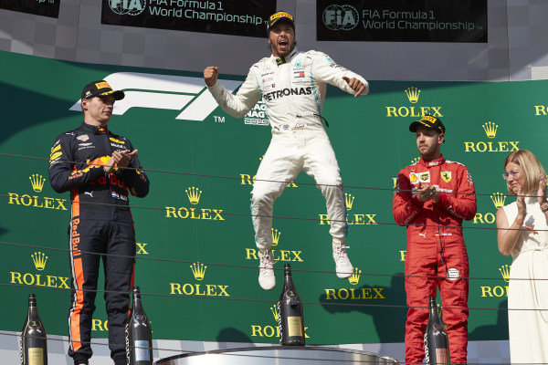 Max Verstappen, Red Bull Racing, 2nd position, Lewis Hamilton, Mercedes AMG F1, 1st position, and Sebastian Vettel, Ferrari, 3rd position, celebrate on the podium