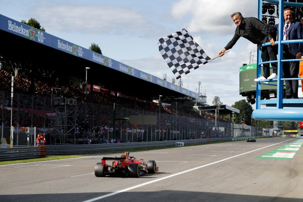 Race Winner Charles Leclerc, Ferrari SF90 crosses the finish line with Jean Alesi waving the chequered flag