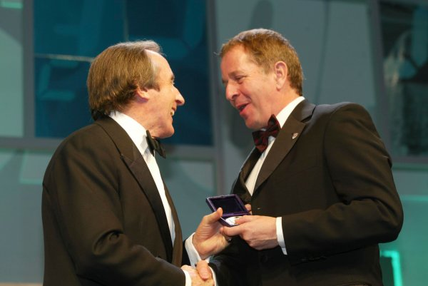 2003 AUTOSPORT AWARDS, The Grosvenor, London. 7th December 2003.Jackie Stewart hands the highest honour from the BRDC to Martin Brundle in the form of a Gold Medal.Photo: Peter Spinney/LAT PhotographicRef: Digital Image only