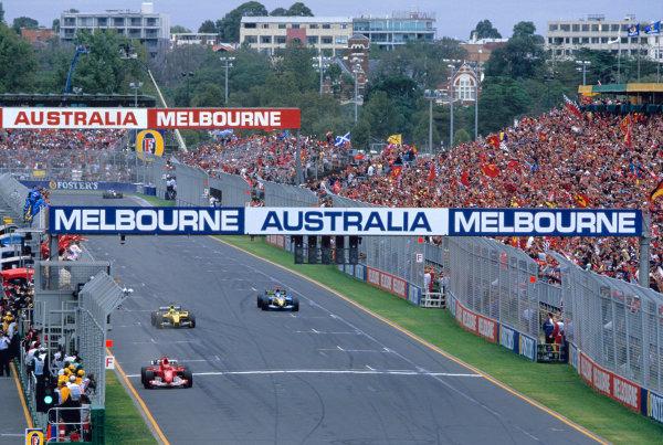 2004 Australian Grand PrixMelbourne, Australia. 5th - 7th March 2004.Michael Schumacher, Ferrari F2004 crosses the finishing line.World Copyright: Charles Coates/LAT Photographic Ref: 35mm Image 04 Aus 30