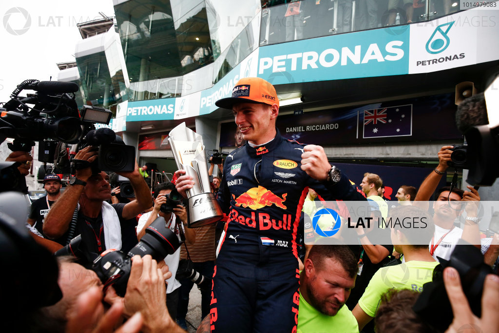 Sepang International Circuit, Sepang, Malaysia. Sunday 1 October 2017. Max Verstappen, Red Bull, 1st Position, celebrates with his team and his trophy. World Copyright: Andrew Hone/LAT Images  ref: Digital Image _ONY5599