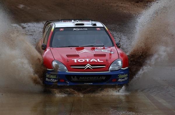 Carlos Sainz (ESP) with co-driver Marc Marti (ESP) Citroen Xsara WRC heads through a mud bath.World Rally Championship, Rd10, Telstra Rally Australia, Day 3 Perth, Australia, 7 September 2003.DIGITAL IMAGE
