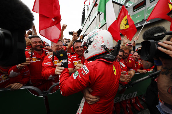 Sebastian Vettel, Ferrari, 1st position, celebrates in Parc Ferme with his team.