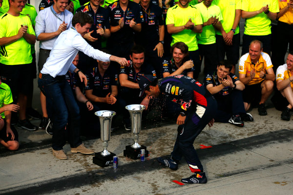 Hungaroring, Budapest, Hungary. Sunday 27 July 2014. Daniel Ricciardo, Red Bull Racing, 1st Position, and the Red Bull team celebrate victory. World Copyright: Andy Hone/LAT Photographic. ref: Digital Image _ONY2824