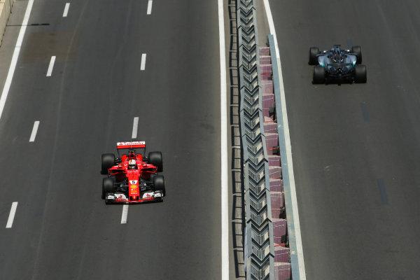 Baku City Circuit, Baku, Azerbaijan. Friday 23 June 2017. Sebastian Vettel, Ferrari SF70H, and Lewis Hamilton, Mercedes F1 W08 EQ Power+, on opposite sections of the circuit. World Copyright: Charles Coates/LAT Images ref: Digital Image AX0W4976