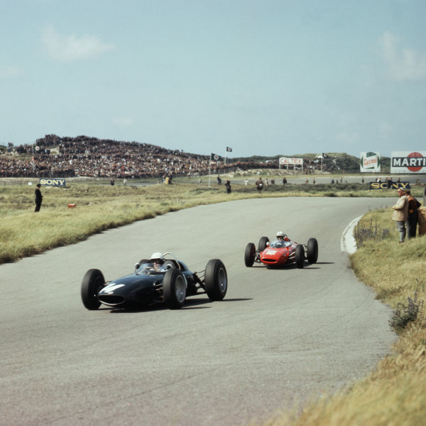 Zandvoort, Holland.21-23 May 1963.Richie Ginther (BRM P57) leads John Surtees (Ferrari Dino 156). They finished in 5th and 3rd positions respectively.Ref-3/0961B.World Copyright - LAT Photographic