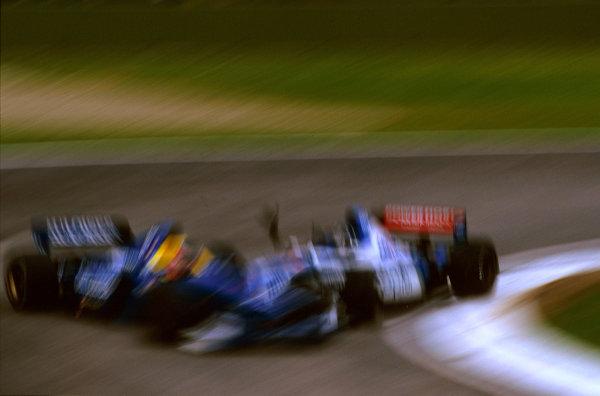 Imola, San Marino.25-27 APRIL 1997.Damon Hill (Arrows A18 Yamaha) runs into the back of Shinji Nakano (Prost JS45 Mugen Honda) on lap 11.Ref-97 SM 03.World  Copyright - LAT Photographic