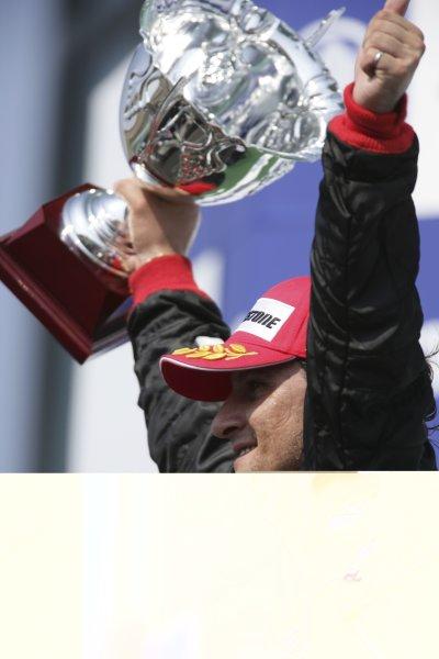 2006 GP2 Series. Round 7 . Magny-Cours, France. 16th July.Sunday RaceGiorgio Pantano (ITA, FMS International). celebrates victory on the podium.World Copyright: Charles CoatesGP2 Series Media Service. ref: Digital Image ZK5Y9453